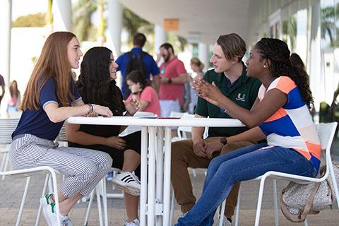 students having a discussion at Shalala